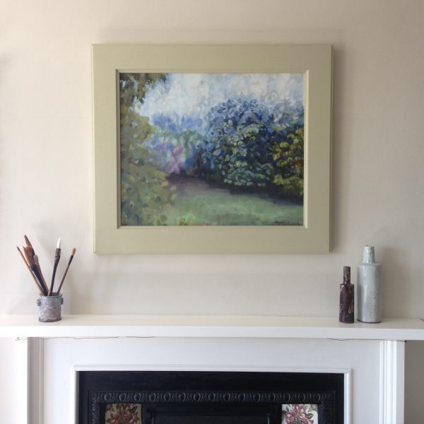 a photograph of a framed oil painting on a mantelpiece title 'Orchard Mist, Towards the Ash Tree' by artist Catherine Coulson © 2019 Catherine Coulson