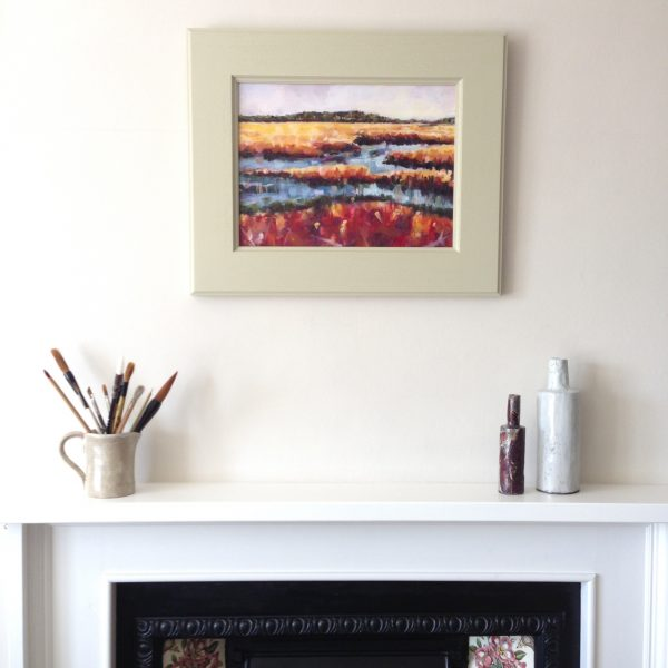 a photograph of an oil painting title 'Hen Reedbeds' on a mantelpiece by Catherine Coulson © 2020 Catherine Coulson catcoulson.art