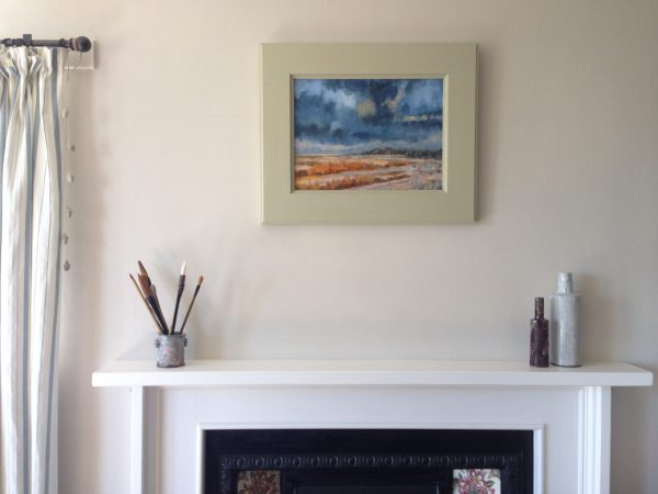 a photograph of a framed oil painting on a mantelpiece title 'Southwick Coast' by artist Catherine Coulson © 2019 Catherine Coulson