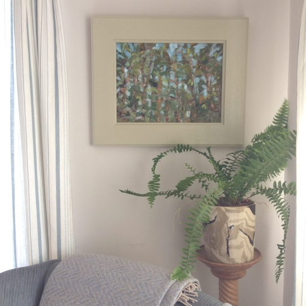 a photograph of a framed oil painting on a mantelpiece title 'Scots Pines, Kirkconnell Flow' by artist Catherine Coulson © 2019 Catherine Coulson