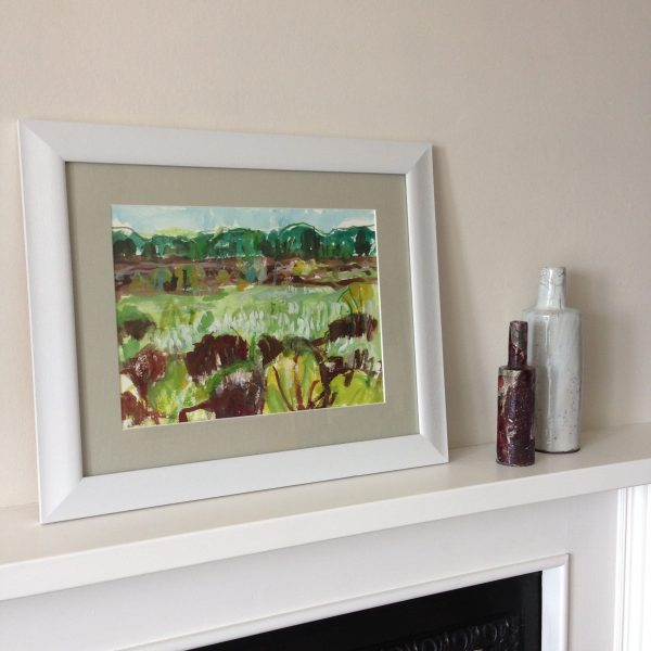 a photograph of a framed painting on a mantelpiece by artist Catherine Coulson title 'Cottongrass and Peat, Kirkconnell Flow ' © 2019 Catherine Coulson