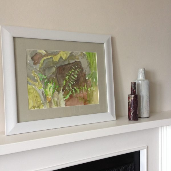 a photograph of a framed painting on a mantelpiece by artist Catherine Coulson title 'Unfurl' © 2019 Catherine Coulson