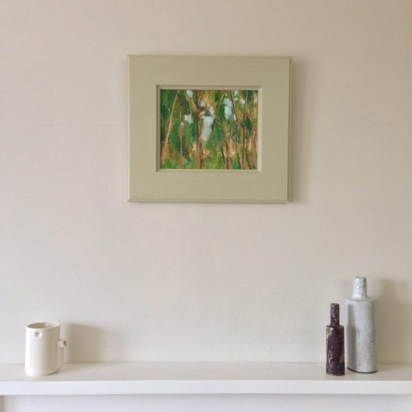 a photograph of a framed painting by artist Catherine Coulson title 'Treetops, Carstramon Wood' © 2018 Catherine Coulson