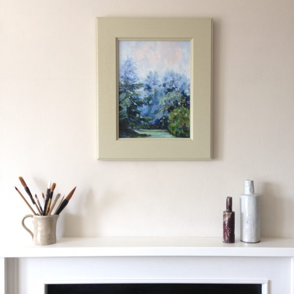 a photograph of an oil painting title 'Orchard Mist' on a mantelpiece by Catherine Coulson © 2020 Catherine Coulson catcoulson.art