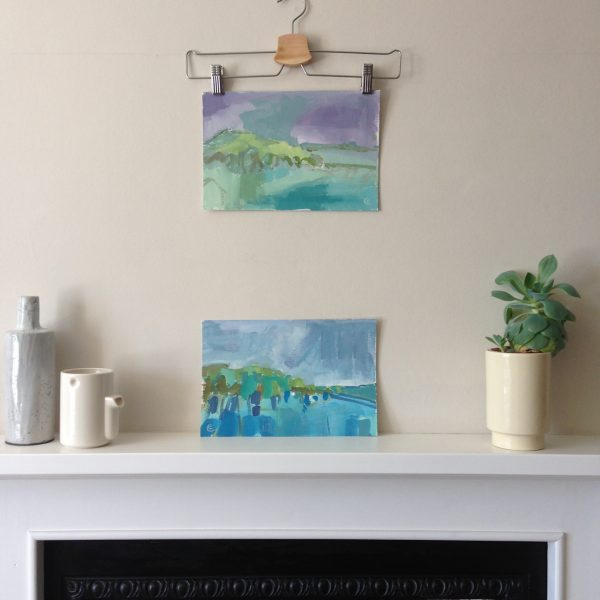 a photograph of an oil painting title 'Rough Island, Dawn' on a mantelpiece by Catherine Coulson © 2020 Catherine Coulson catcoulson.art