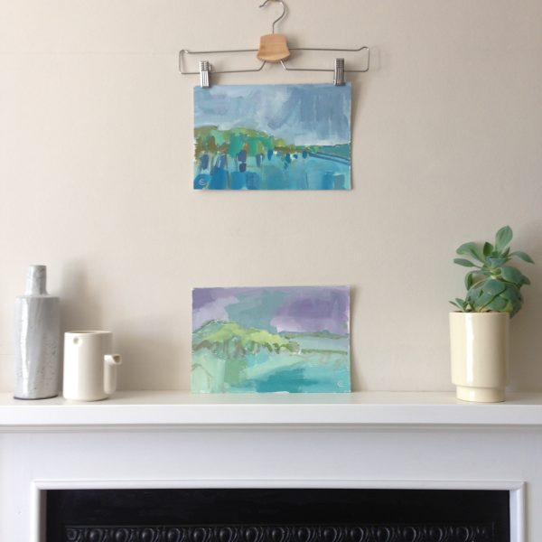 a photograph of an oil painting title 'Rough Island, Summer' on a mantelpiece by Catherine Coulson © 2020 Catherine Coulson catcoulson.art